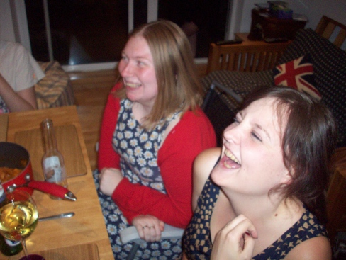Probably laughing at some witty anecdote of mine