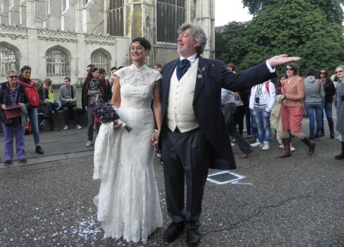 Bride, groom, excited tourists
