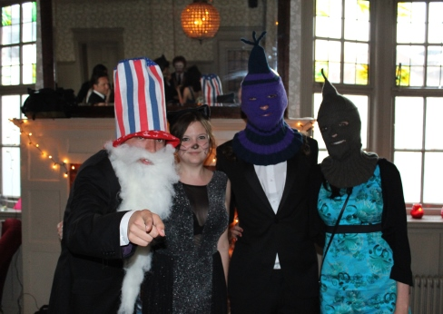 Uncle Sam, a cat, and two masked somethings