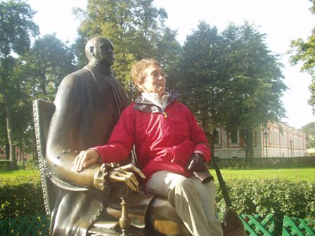Sitting on the statue