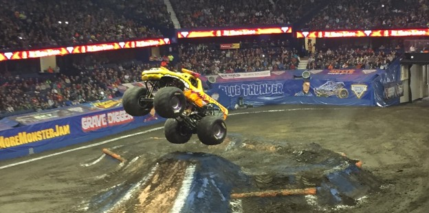 A monster truck jumps through the air