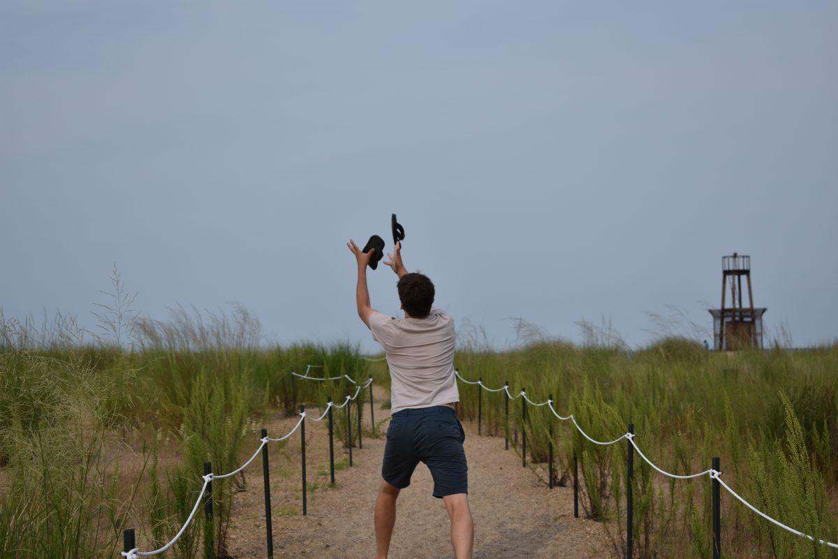 Deftly juggling my flip flops at Loyola Beach