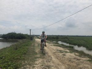 Cycling by the Truong Giang River in the countryside around Hoi An, Vietnam