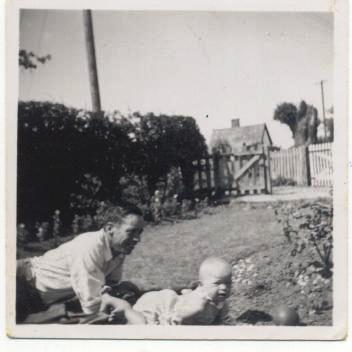 My dad with his dad, George, in their garden as a baby